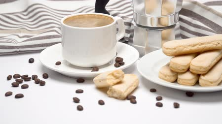 desperto : White ceramic cup of coffee with a savoiardi ladyfinger cookie on a plate