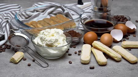 composição : Ingredients for making traditional italian cake tiramisu on concrete table