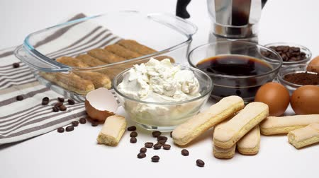 composição : Ingredients for making traditional italian cake tiramisu on white background Stock Footage