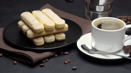 fasola : Italian Savoiardi ladyfingers Biscuits and cup of coffee on concrete background