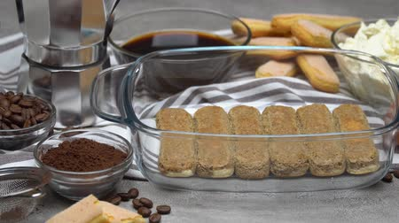 composição : Ingredients for traditional tiramisu cake on concrete background Stock Footage