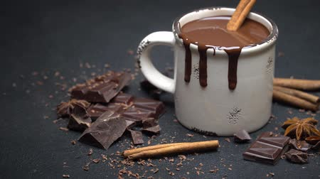 kufel : Cup of hot chocolate and pieces of chocolate on dark concrete background
