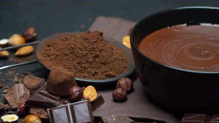 ceramika : ceramic bowl of chocolate cream or melted chocolate, nuts and pieces of chocolate
