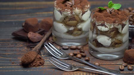 yermantarı : two portions Classic tiramisu dessert in a glass on wooden background Stok Video