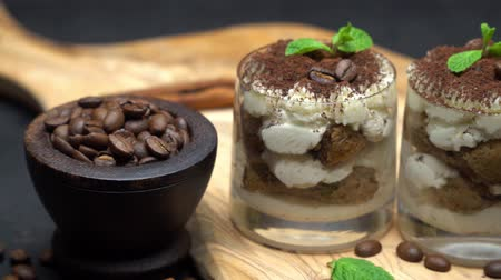 rustico : Classic tiramisu dessert in a glass on dark concrete background