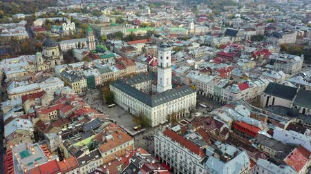 Aerial drone video of Lviv Old City center - roofs and streets, city hall Ratusha Stock Footage