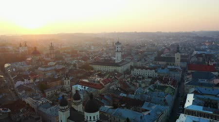 Aerial drone video of Lviv Old City center - roofs and streets, city hall Ratusha Stok Video
