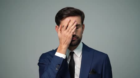 facepalm : full hd video of young handsome stylish businessman - 4x slow motion