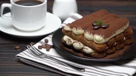menta : Classic tiramisu dessert on ceramic plate, cream or milk and cup of coffee on wooden background