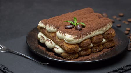 fincan tabağı : Classic tiramisu dessert on ceramic plate on concrete background