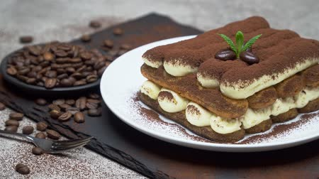 menta : Classic tiramisu dessert on ceramic plate on concrete background