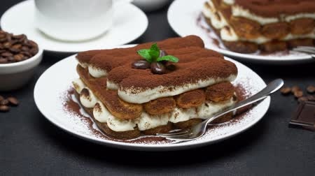 fincan tabağı : Classic tiramisu dessert, cup of coffee, sugar and milk on concrete background Stok Video