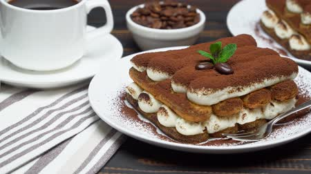 çatallar : Two portions of Classic tiramisu dessert, cup of coffee and milk or cream on wooden background
