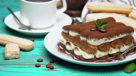 handdoek : portion of Classic tiramisu dessert, cup of coffee and milk or cream on wooden background