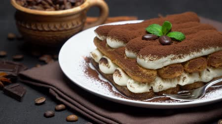 kufel : Classic tiramisu dessert on ceramic plate on dark concrete background