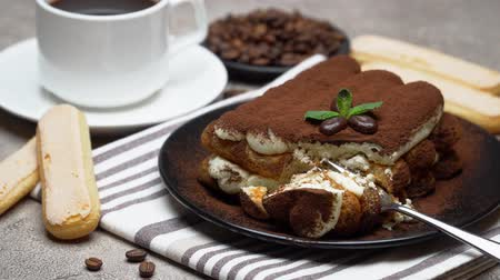 villa : portion of Classic tiramisu dessert and savoiardi cookies on concrete background Stock mozgókép