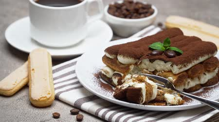 çatallar : portion of Classic tiramisu dessert and savoiardi cookies on concrete background Stok Video