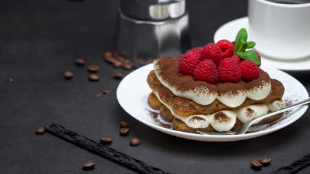 jagody : portion of tiramisu dessert with raspberries, espresso and coffee maker on concrete background