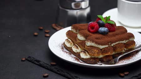 jagody : tiramisu dessert with raspberries and blueberries, espresso and coffee maker on concrete background