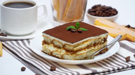 tampas : Tiramisu dessert square portion, savoiardi cookies and cup of coffee on white background