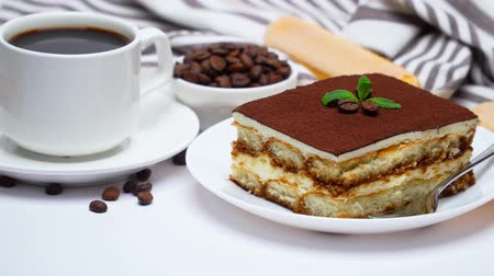 tampas : Tiramisu dessert square portion, savoiardi cookies and cup of coffee isolated on white background