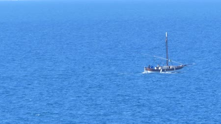 industrial fishing : Old fishing boat browsing the sardinian sea in the gulf of asinara