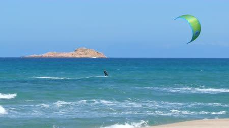 sardinie : kite surfing in front of the island in Sardinia, in a windy day