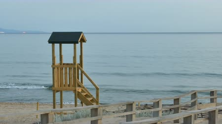 sardinie : Wooden lifeguard on a beach in a summer morning