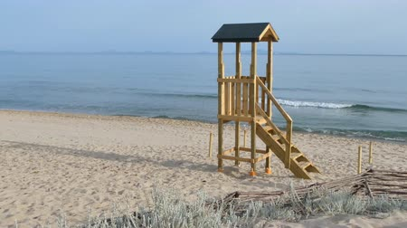 guards : Wooden lifeguard on a beach in a summer morning
