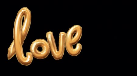 Animation golden LOVE balloons on black background.