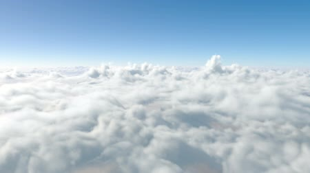 át : flying above the clouds. through the clouds. paradise
