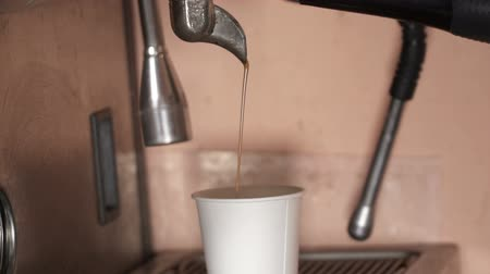 latte macchiato : closeup of espresso pouring into plastic cup, slow motion Stock Footage