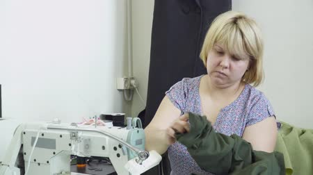 parecer : Woman creating clothes on the clothing factory