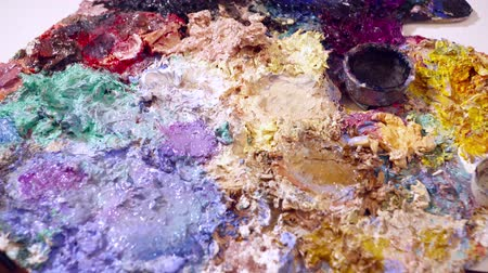 expressionism : Closeup of different paint on the palette Stock Footage