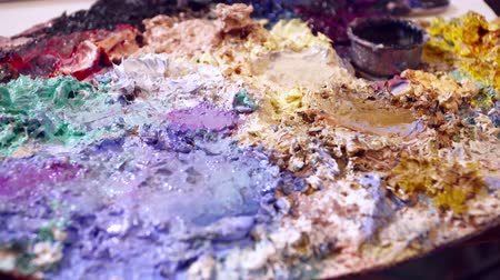 expressionism : Different color paint on the palette closeup