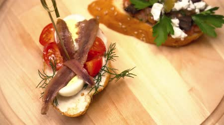 bruschetta : Tapas on wooden board with cheese and fish closeup