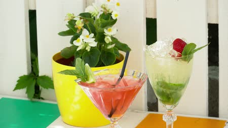prepairing : Closeup of two cocktails on the table with a flower