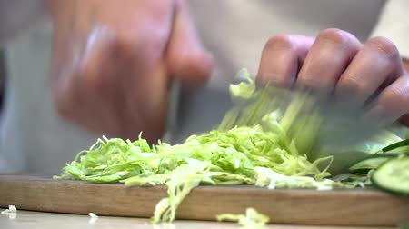 marul : Closeup of the chef cutting cucumber