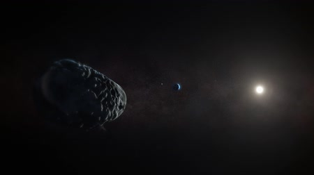solar : Asteroid Flips Towards Earth. a asteroid flips towards earth. doomsday is here! air pockets explode off the face of the  rock as it heads towards its target. smaller rocks spin around the larger rock. Stock Footage