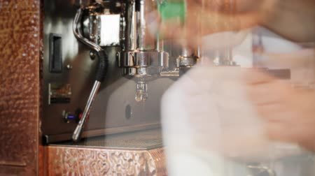 coffee time : Espresso Time Lapse. a Timelapse shot of employees working with an espresso machine as the camera slowly zooms in. Stock Footage
