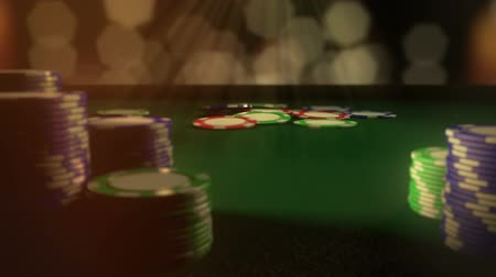 játékpénz : Gambling Chips Fall Animation. Camera pans right behind stacks of chips to a bunch of poker chips falling into the middle. clip has luma matte of close poker chips for easy compositing. Stock mozgókép