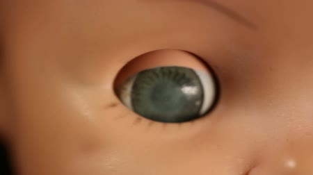 долл : Old Baby Doll Eye Detail. macro shot of an old baby doll face. camera moves around and racks focus