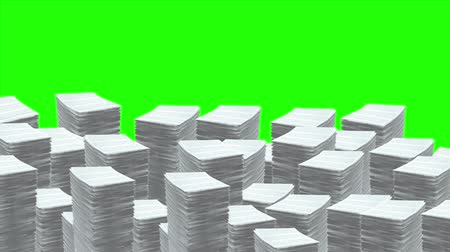 rakás : Stacks of Paper Pile Up. Stacks of paper pile up and fill bottom half of screen. On green backdrop.  Clip comes with Luma Matte for isolation Stock mozgókép