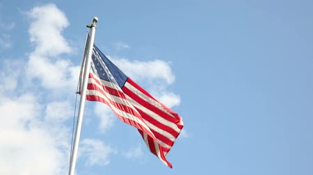 bandeira americana : USA Flag Wave and Sun. 2 shots of the flag waving. against blue sky and backlit against the sun