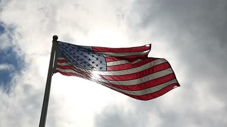 usa : USA Flag Wave Slow Motion. a flag waves in slow motion backlit by the sun during the day Dostupné videozáznamy