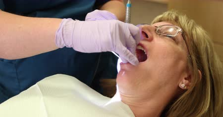 зубы : Dental Check Up in Mouth Dolly Right. camera moves right as dentist checks out a female patients teeth.