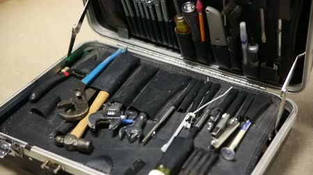 toolbox : Tool Case Tilt Down. camera tilts down on an old case filled with work tools. close up.