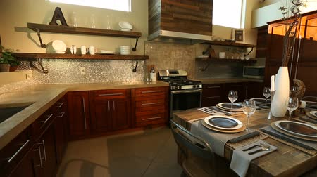 мебель : Modern Kitchen Dolly Left from Sun Flare Through Window. camera moves left on a modern kitchen. Sun flare coming through large windows showing all details of the kitchen and move to sink