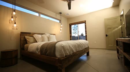 dekoracje : Bedroom Rising Shot on Bed from Low Angle. camera rises from the floor in a bedroom to reveal the bed and modern decoration to ceiling with ceiling fan Wideo