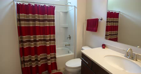 çini : Modern Guest Bathroom Rise Up . a rising shot of a traditional modern contemporary guest bathroom in a new home. Red decorations Stok Video